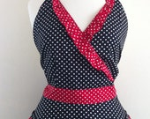 Retro apron crossed over, white polka dot on a black fabric. 1950s inspired, fully lined.