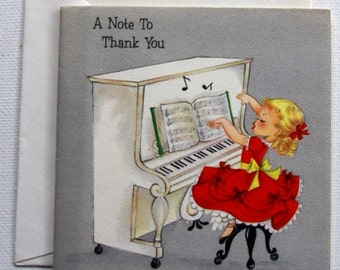 1940s vintage  girl with piano Christmas Thank you AND New Year card, unused, with envelope