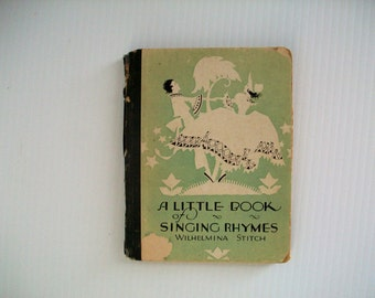 1st edition . antique book . A Little Book of Singing Rhymes Wilhelmina Stitch . vintage Volland Company gift books