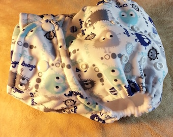 SassyCloth one size pocket cloth diaper with blue/ gray ooga booga  PUL print. Ready to ship.