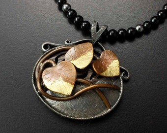 Copper leaf nature inspired Wabi Sabi silver pendant necklace with gold