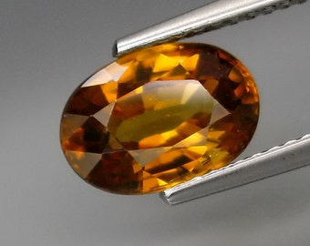Yellow Zircon Oval Faceted Cut, 3.00 Carat, 10 x 7 MM, Deep Cognac To Orange, Natural And Genuine, Tanzania