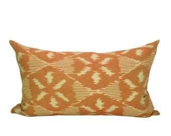 Schumacher Darjeeling Ikat lumbar pillow cover in Persimmon