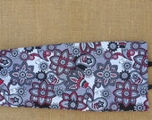 Plastic Bag Holder - Black, red, and white paisley floral print