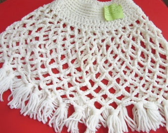 Vintage poncho child size white fringed circa 1973 label reads made for first grader
