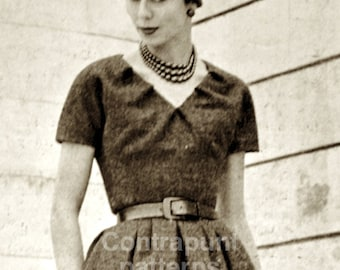 1950 Cristian Dior Pattern with large pleats at the waist and darted V-neck