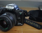 Minolta MAXXUM 330si Rz date 35mm film camera with Quantaray 35-80mm 1:4-5.6 telephoto zoom lens.