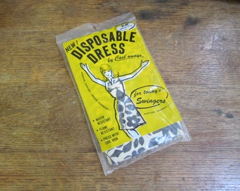 The Original Disposable Dress!! New Unopened Throw Away Dress. By  Cast' Aways. Modern throwaway chic. water flame resistant dress.