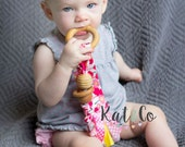 Natural maple teething ring and organic fabric.  Can be personalized. You choose organic fabric