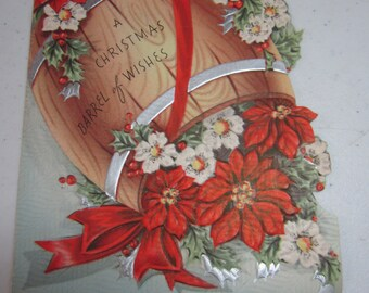 Very pretty embossed silver gilded die cut 1940's-50's christmas card wooden barrel full of red poinsettias  white flowersholly berry