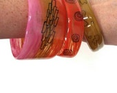 Becca Cook - Repurposed handpainted water bottle bracelets. Set of three.