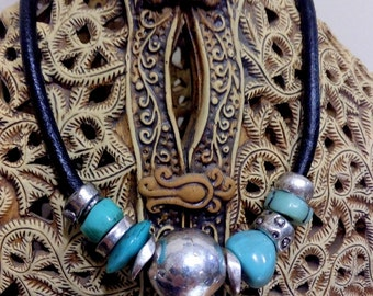 Turquoise Pendant .RudeTurquoise Necklace. Natural Turquoise Necklace. metal ball. metal beads silver color.thick leather lace