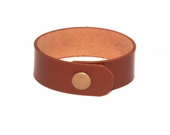 Leather wristband with snaps or tie lace