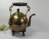 vintage brass tea pot with feet and handle on Sale