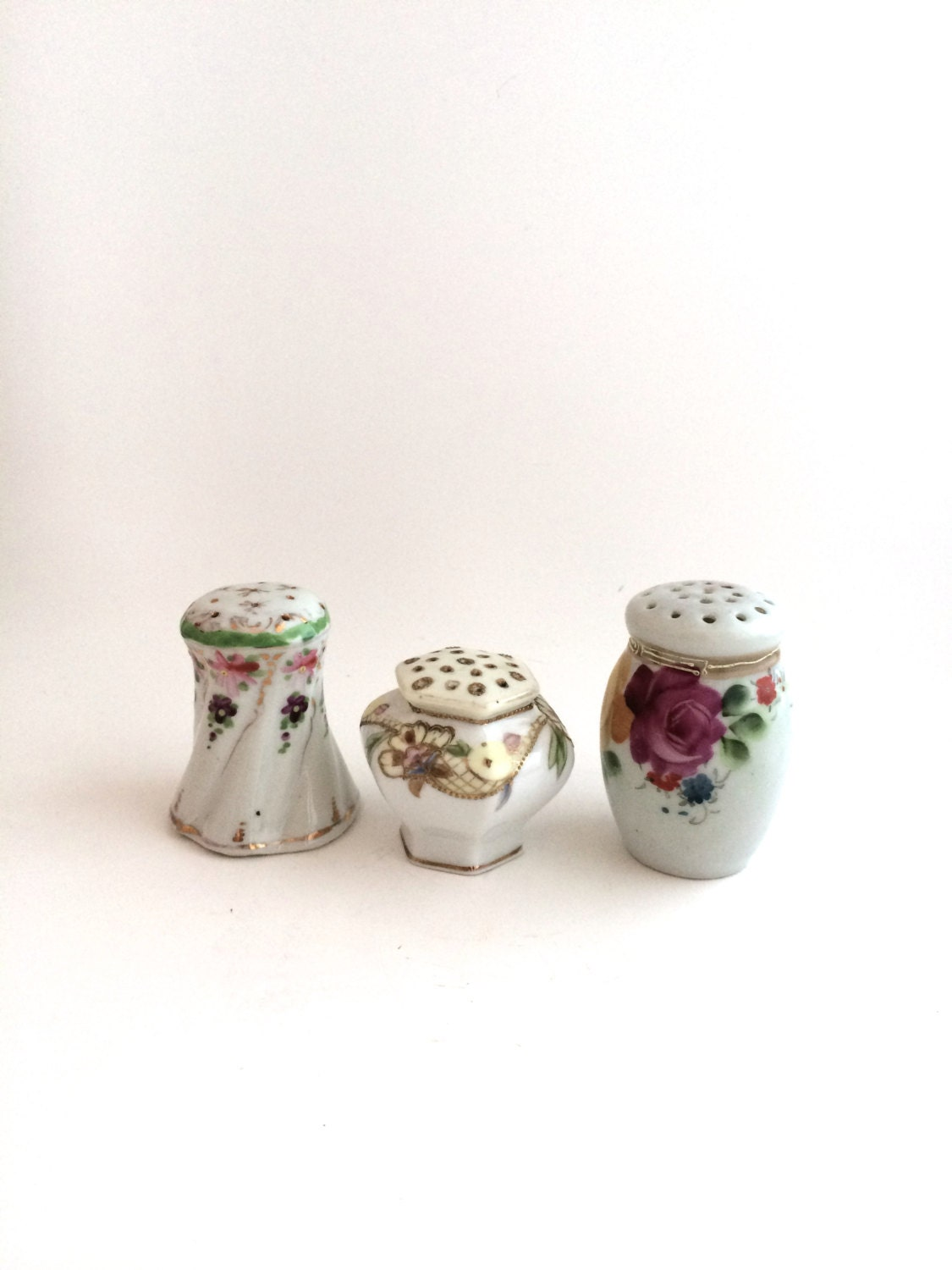 Salt and pepper shakers a trio of design and color Colorful salt and pepper shakers