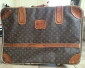 Vintage Louis Vuitton suitcase w/ wheels