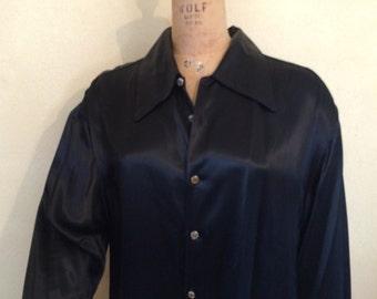Men's shiny long sleeve black large dress shirt.