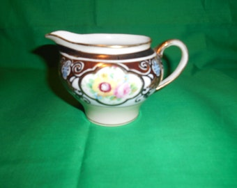 One (1), Porcelain, Hand Painted, Nippon Noritake Creamer, in a Unknown Pattern.