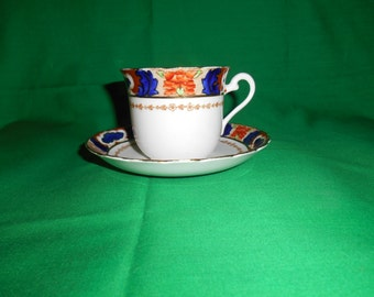 One (1), Bone China, Flat Tea Cup and Saucer, from Plant Tuscan, in the 9523 Pattern.