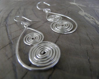 "Earrings... ""North Winds"" handmade and hammered sterling silver wire earrings."