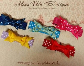 One set with 5 handmade hair clips with coordinating bows!