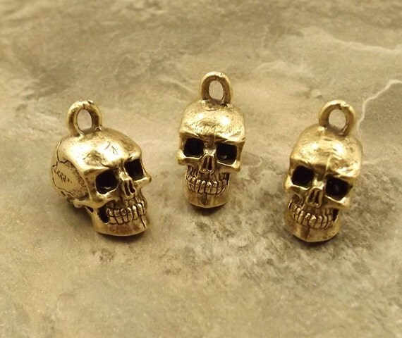 Three (3) Pewter Gold Tone Skull Charms - 5243