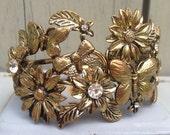 Vintage bracelet   Gold toned daisy butterfly bow rhinestone hinged cuff costume jewelry bracelet
