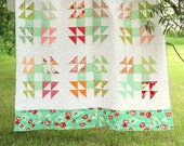 Robin's Nest quilt pattern - traditional single wedding ring block made into a modern quilt using a layer cake - double size quilt pattern