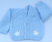 Premature baby cardigan hand knitted in pale blue . Baby clothes and baby sweaters.