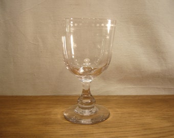 Antique glass rummer with engraved stars and circles border