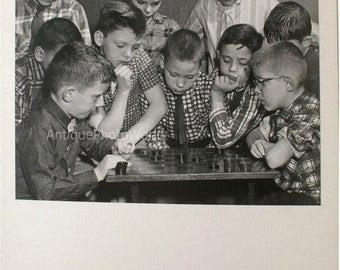 Children playin checkers vintage photo by Tranquille
