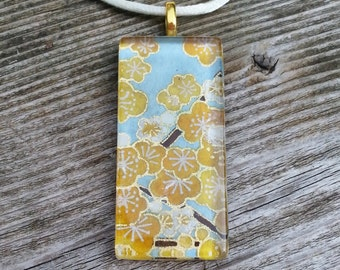 Glass pendant necklace made with Japanese Chiyogami paper and gold plated bail