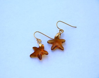 Summer earrings - Small pendants - Gold plated elements, starfish shapped genuine Swarovski cristals in transluscent orange