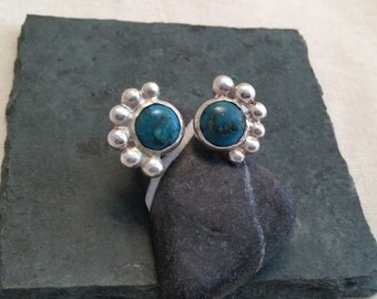 Chrysocolla floating ring with sterling silver granulation decoration.