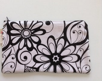 White and black zippered Tola clutch.  Lislyn Designs.  Clutch, makeup bag.