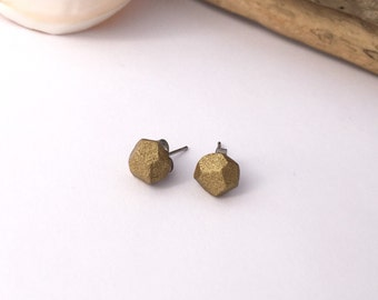 Rich rustic gold, organically faceted eco-resin earrings. Surgical steel studs.