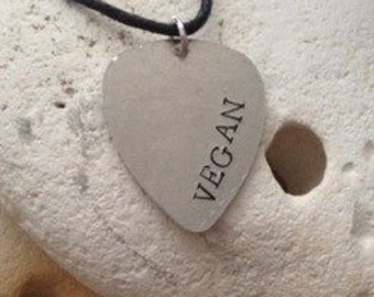 Vegan guitar plectrum necklace on black cotton cord