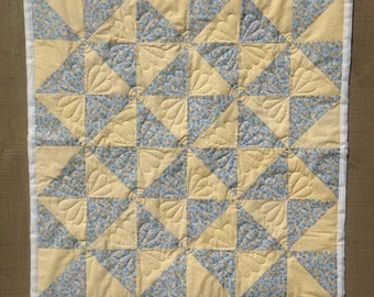 Blue and Yellow Pinwheel crib quilt