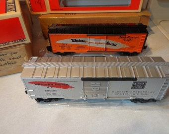 Lionel electric trains Western Pacific boxcars 2 TTOS,1995,and 1993 new in boxes,silver & orange cars