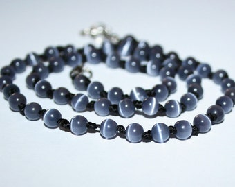 Beads cat's eye 4 mm. Strand of beads gray cat's eye.