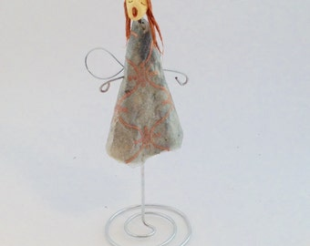 Tiny angel sculpture of handmade paper