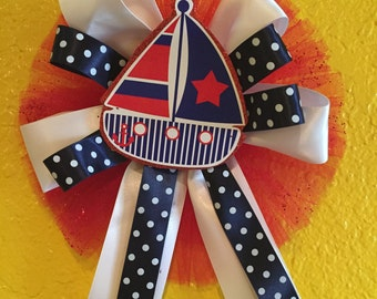 Sailboat baby shower corsage-Nautica -Sea Baby Shower Theme