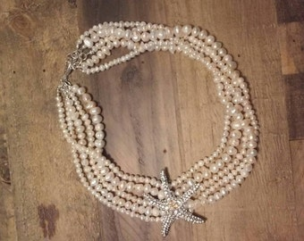 Five Strand Freshwater Pearl Necklace with a Rhinestone Starfish