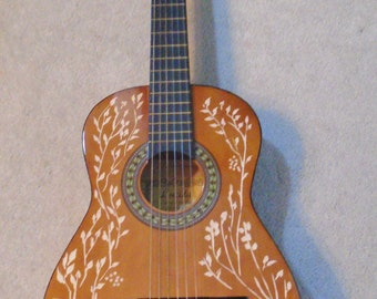 Hand-carved classical acoustic guitar