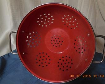 Large vintage red enamelware collander.