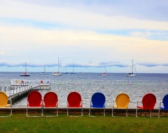 """Bright Colored Chairs Wait For """"Sitters"""" on a Rainy Summer Day"""