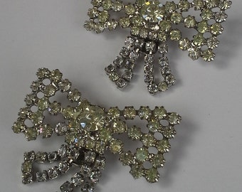 Vintage pair of shoe clips  from tip toes silver tone and clear rhinestones