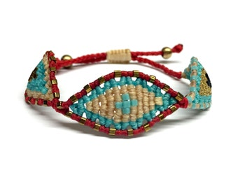 Red and beige, triple eye bracelet