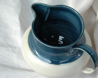 Handmade navy and white ceramic pitcher