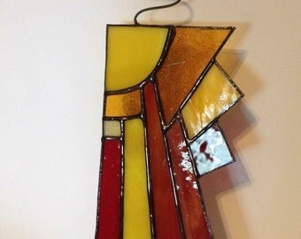 Abstract Stained Glass Sunray! Variations of reds, yellows, and orange with varied textures. Includes antique glass